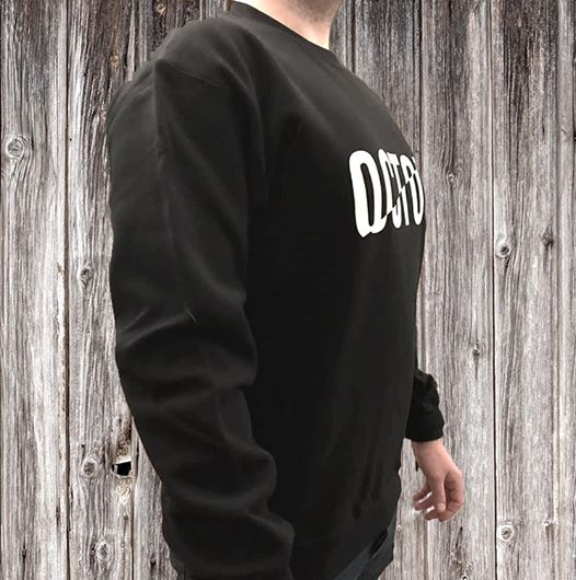 Black OCTOV Sweater on the side